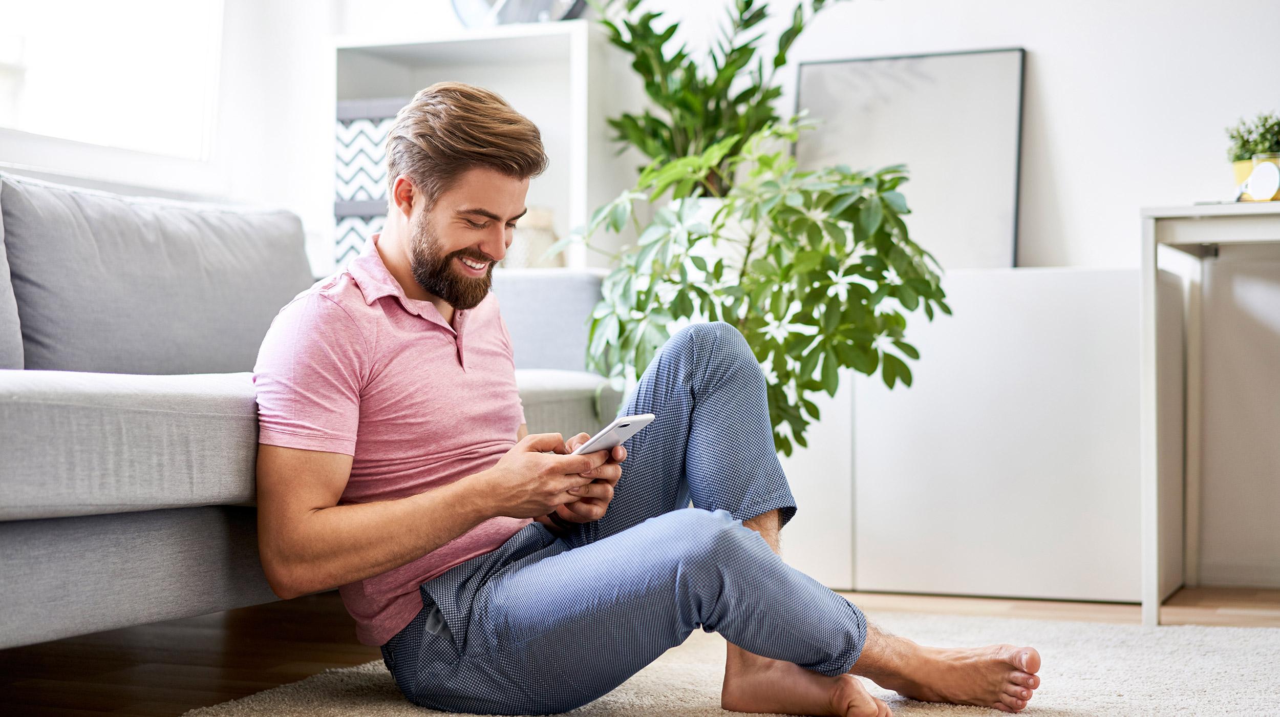 Man enjoying iPad in living room